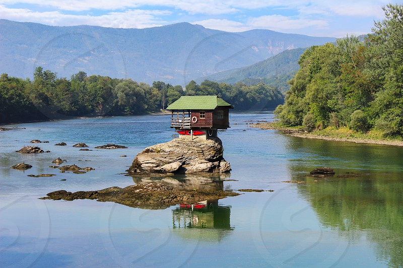 Unique popular Drina house built on the rock on the middle of a Drina river in Serbia. It is a famous landmark of this area. photo