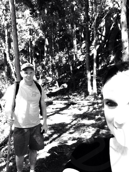 man and woman on forest during daytime photo