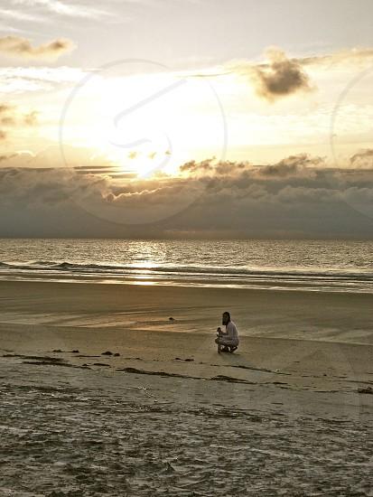 Woman looking for shells on the beach. Hilton Head Island SC photo