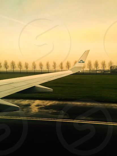 Landing at Schiphol airport at sunrise  photo