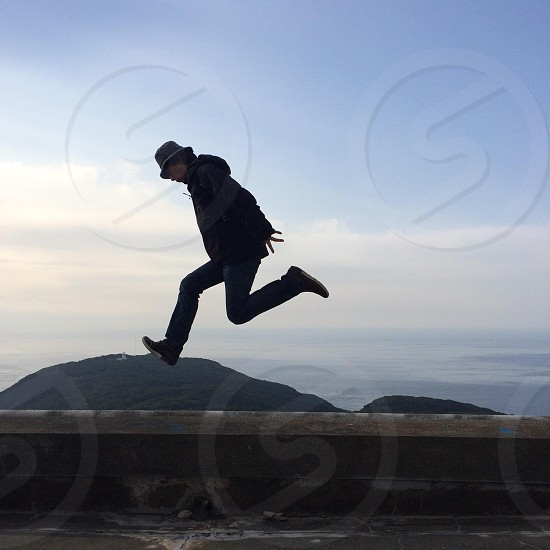 person jumping over ground photo