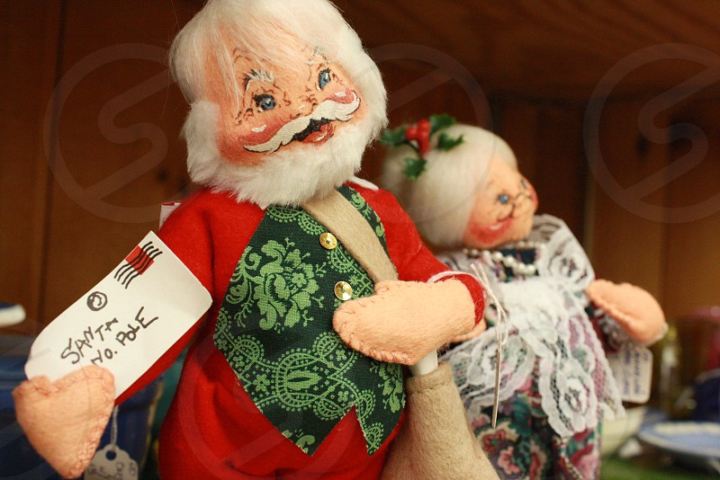 santa clause and a woman tabletop decor photo