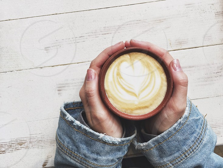 Holding a coffee cup  photo