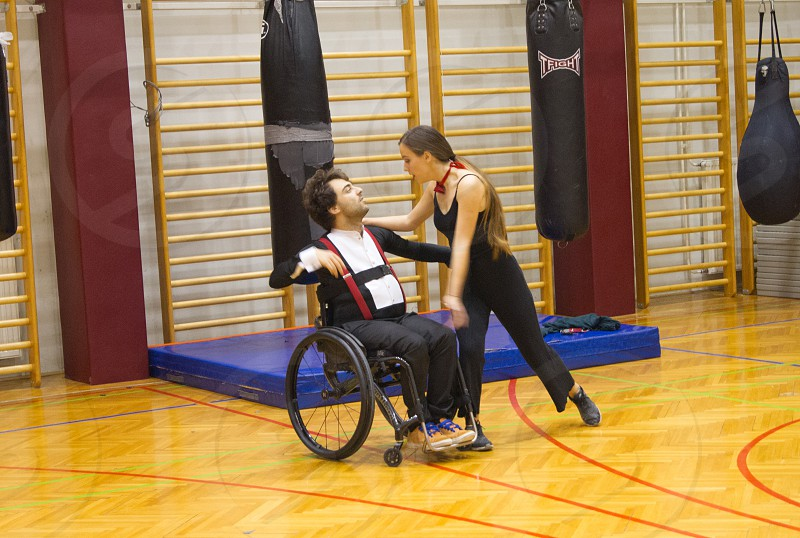 Para dance training. A couple dancing. Person in wheelchair dancing. photo