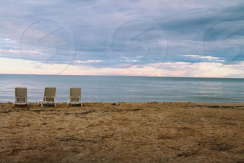 Water twilight dusk beach lake chairs simple  simplicity vacation  quiet  Michigan still  summer  summertime  photo