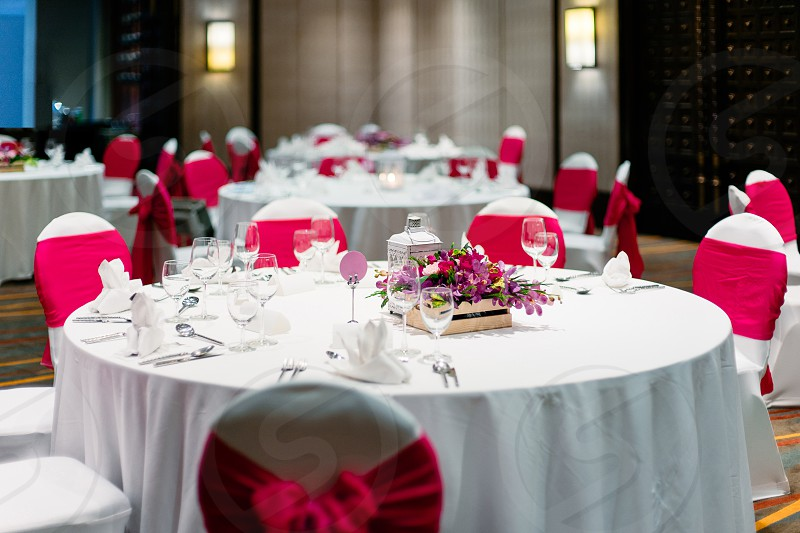 Wedding reception dinner table white and red theme chairs photo