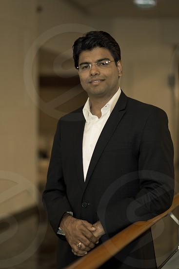 Indian businessman leader wearing smart casual suit posing photo