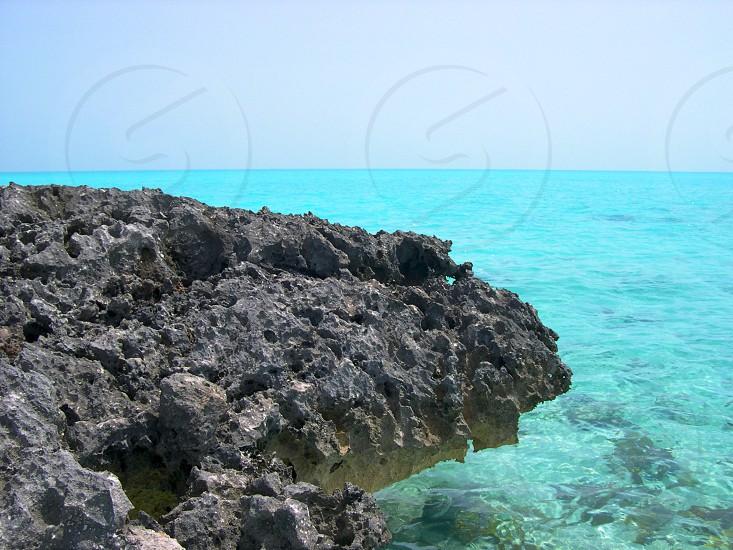 Small cay Bahamas cragly rock teal ocean photo