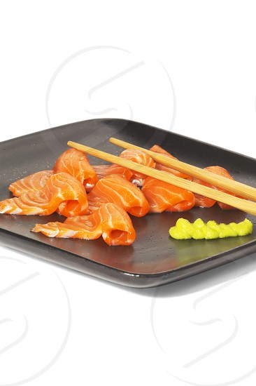 slice of salmon sushi with wasabi sauce photo