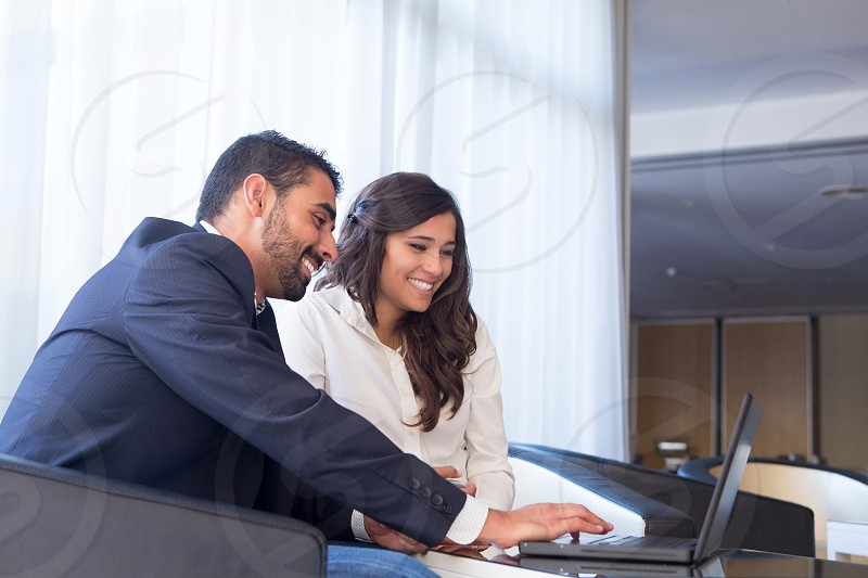 business couple man woman laptop tablet latin hispanic photo