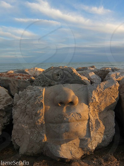 Sculptures in Caorle beach Italy photo