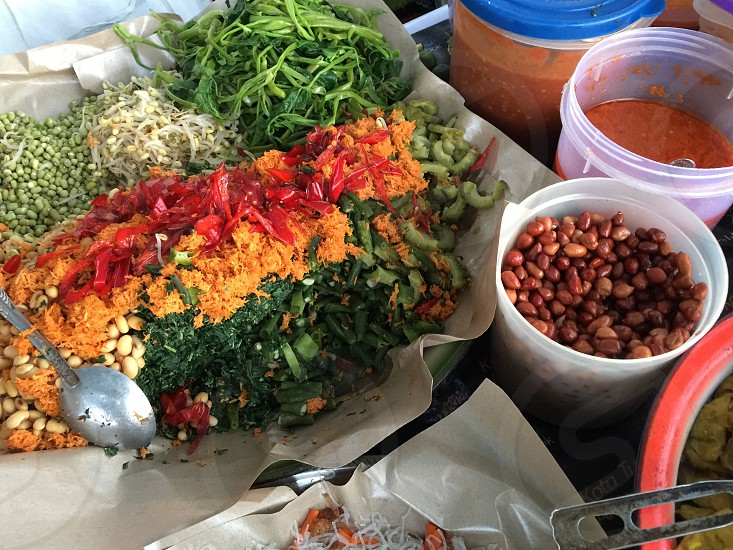 Street Food vegetables Urab Pelecing peanuts  spicy Chills Sauce Morning Glory  photo