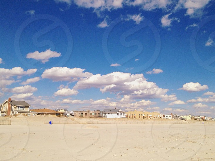 houses on white sand field photo
