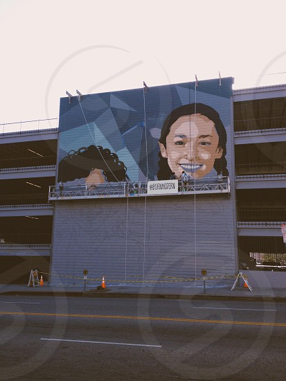 girl's face on gray billboard photo