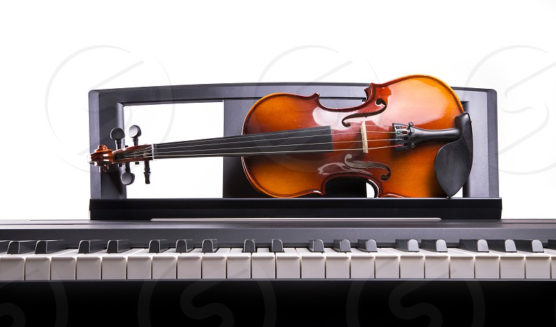 Violin on the desk electronic piano photo