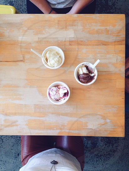 3 cup of ice cream on table photo