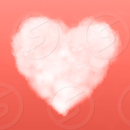 Cloudy white heart of sream on a background in a color of the year 2019 Living Coral Pantone . Place for text. photo