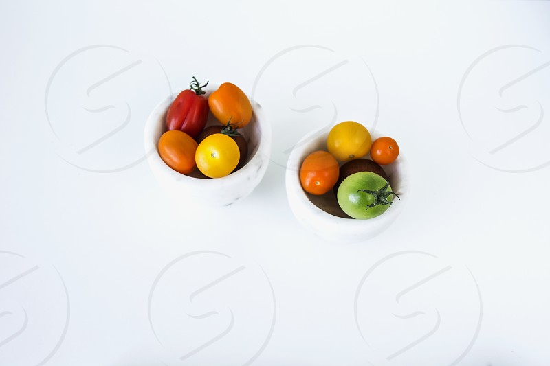 cherry tomatoes; salad; bowls; tiny; white background photo