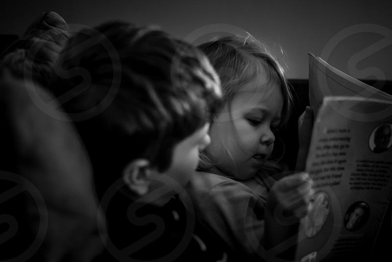 Sibling love siblings brother sister young children childhood reading story connection love loving precious together bonding Nikon Nikon D7100 photo