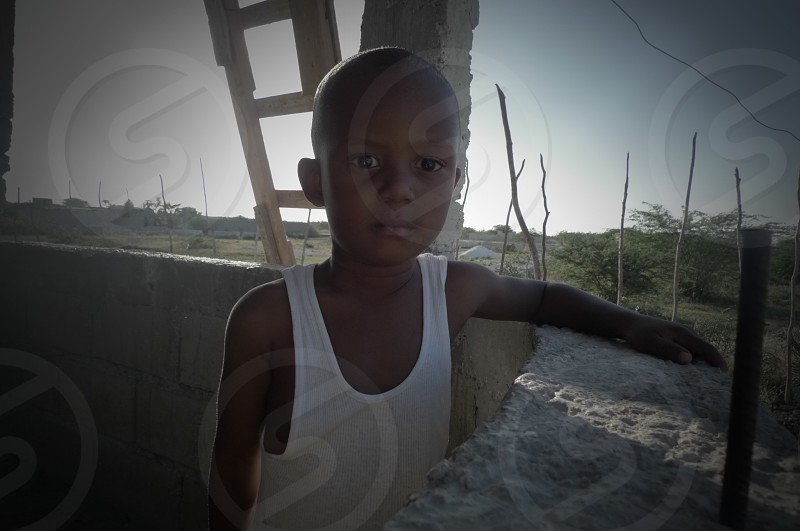 Haiti Young Boy Neighborhood Summer Ladder Porch   photo