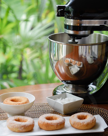 brown donut on white ceramic near black and gray stand mixer photo