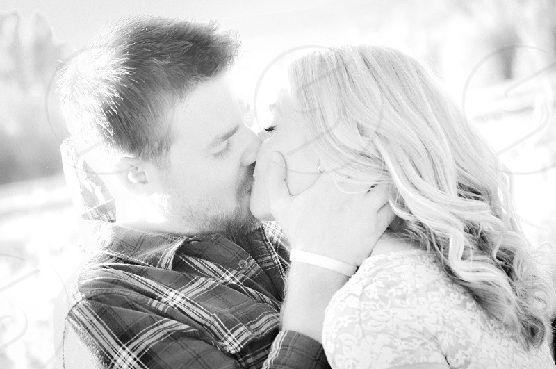 couple kissing on grayscale photography  photo