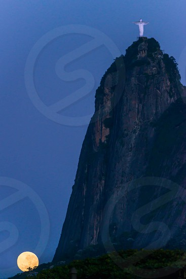THE SUPER MOON PUT ON FOOT OF THE REDEEMER RIO DE JANEIRO BRAZIL photo
