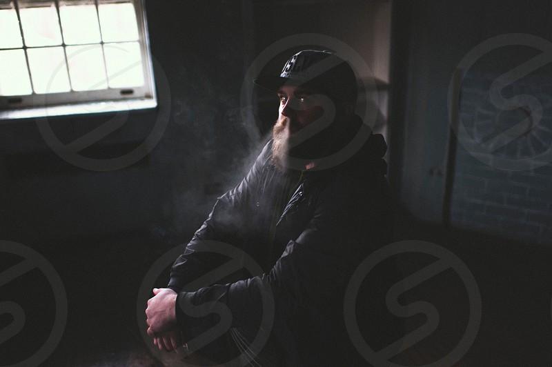 man exhaling smoke through nostrils photo