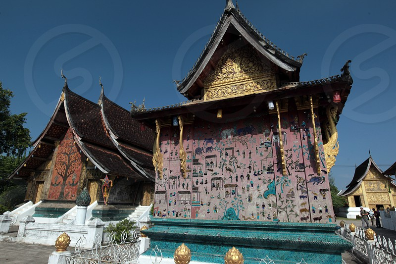 the Tempel Xieng Thong in the old town of Luang Prabang in the north of Lao in Souteastasia. photo