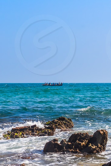 Photograph of Rowing Boat in Sea taken from a distance during Christmas Holiday or New Year celebration time in landscape style Use for background website banner usage Travel vacation holiday concept photo