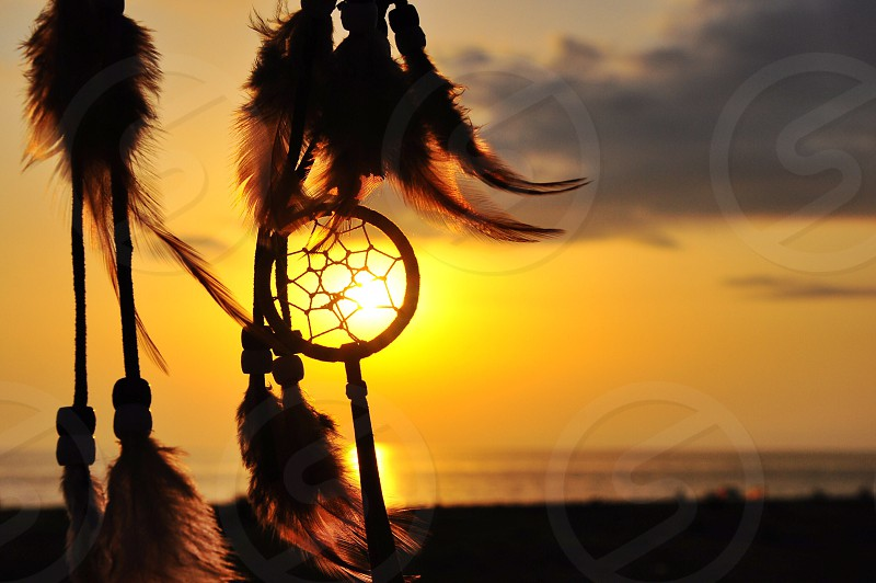 dream catcher on sunset photo
