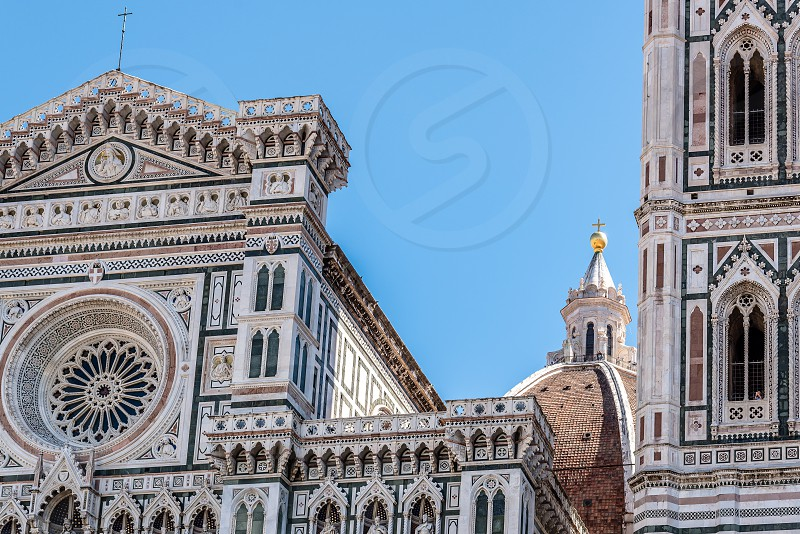 Campanile of Giotto a sunny day of summer. It is a free standing campanile that is part of the complex of buildings that make up Florence Cathedral on the Piazza del Duomo photo