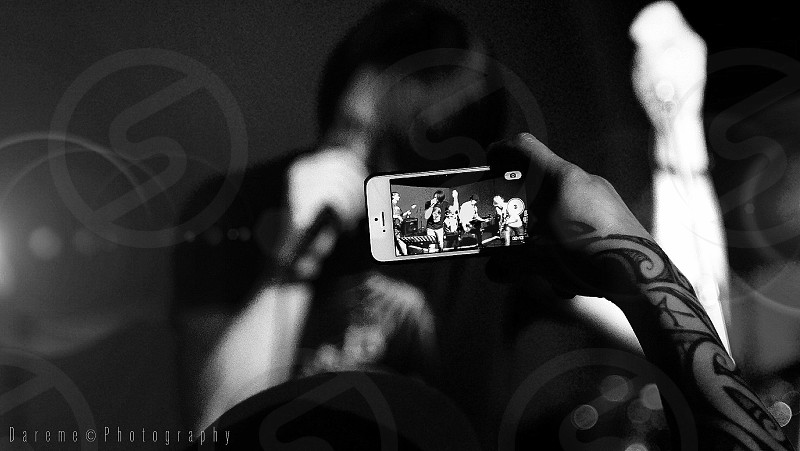white iphone showing rock band photo