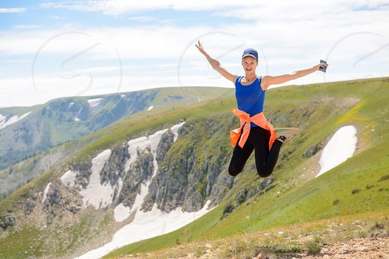 nature woman female travel hiking using mobile photo mountains Kazakhstan beautiful summer dayhappiness freedom photo