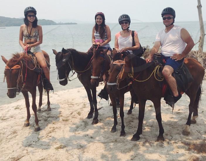 Family vacation- horse back riding on  the beach at Roatan Honduras photo