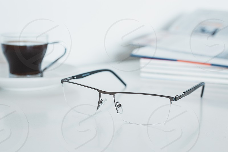 Glasses with book and coffee photo