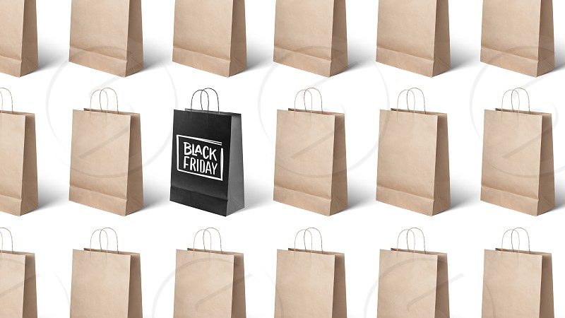 on white background many paper bags black Friday photo