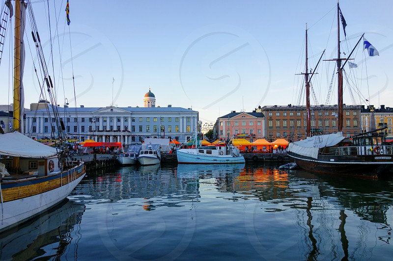 Helsinki Market Square at the annual Baltic Herring Fair with wooden sailboats in the harbor on 7 October 2015.  photo