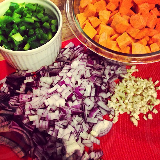 slices onions garlic green pepper and squash photo