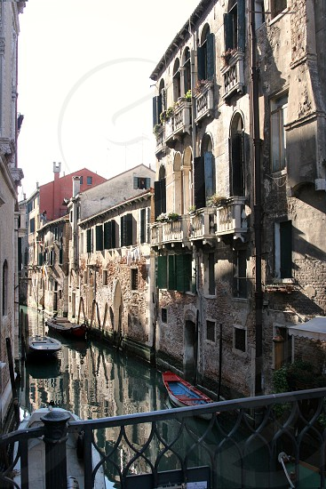 boats on water between buildings photo
