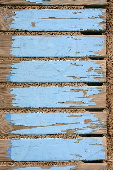 aged beach blue wooden floor over summer sand photo