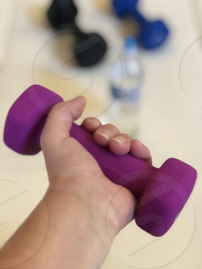 Heath and wellness fitness weights working out exercise arm exercising exercising equipment well being prosperity hand photo