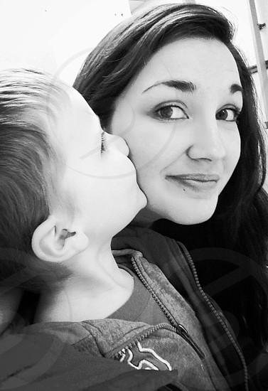 boy kissing woma photo