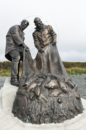UST-KAMCHATSKY KAMCHATKA RUSSIA - SEP 20 2015: View of Monument to fishermen or Monument to Fisherman's glory (two fishermen pulling a fishing net with fish). Kamchatka Peninsula Far East Russia. photo