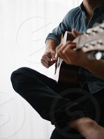 Guitar player with his guitar photo