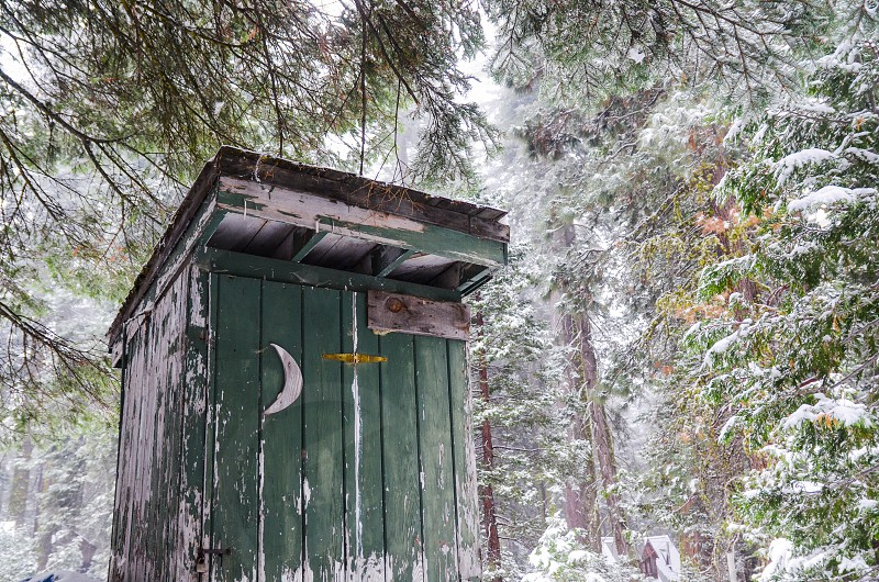 outhouse winter wonderland snow forest cabin photo