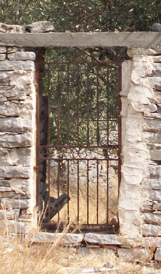 Gateway  - gateway to heaven - hole in a wall - walled garden - Greek gate - Greece - ironwork - iron gate - metal gate -  photo