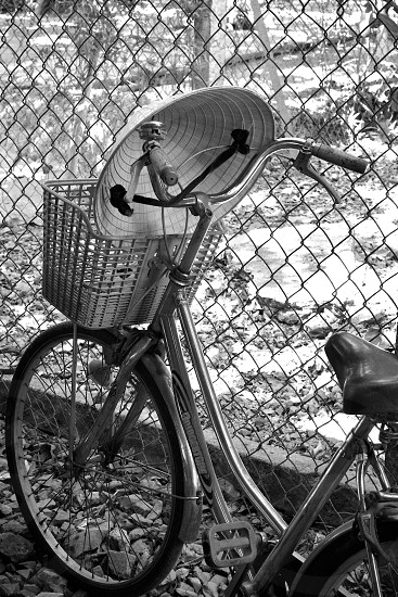 Bicycle and conical hat in a Vietnamese village... photo