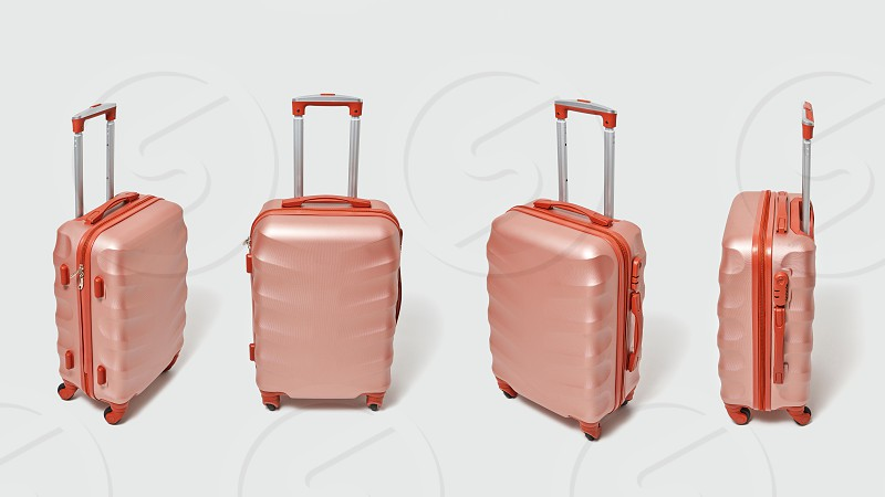 Four modern brown suitcases on a gray background with copy space for text. The concept of travel and tourism. photo