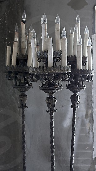 Errie dusty ornate candelabras in abandoned house photo